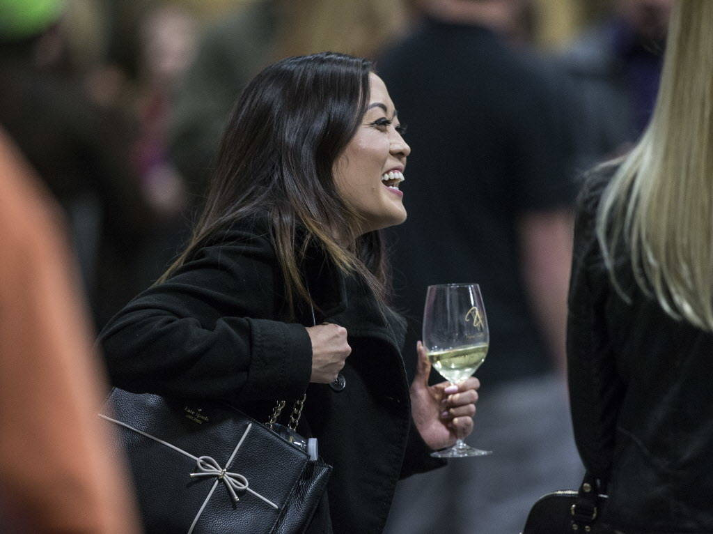 Lilly Tran enjoys a glass of wine during the grand opening of Vegas Valley Winery on Saturday, January 20, 2018, in Las Vegas. Benjamin Hager Las Vegas Review-Journal @benjaminhphoto