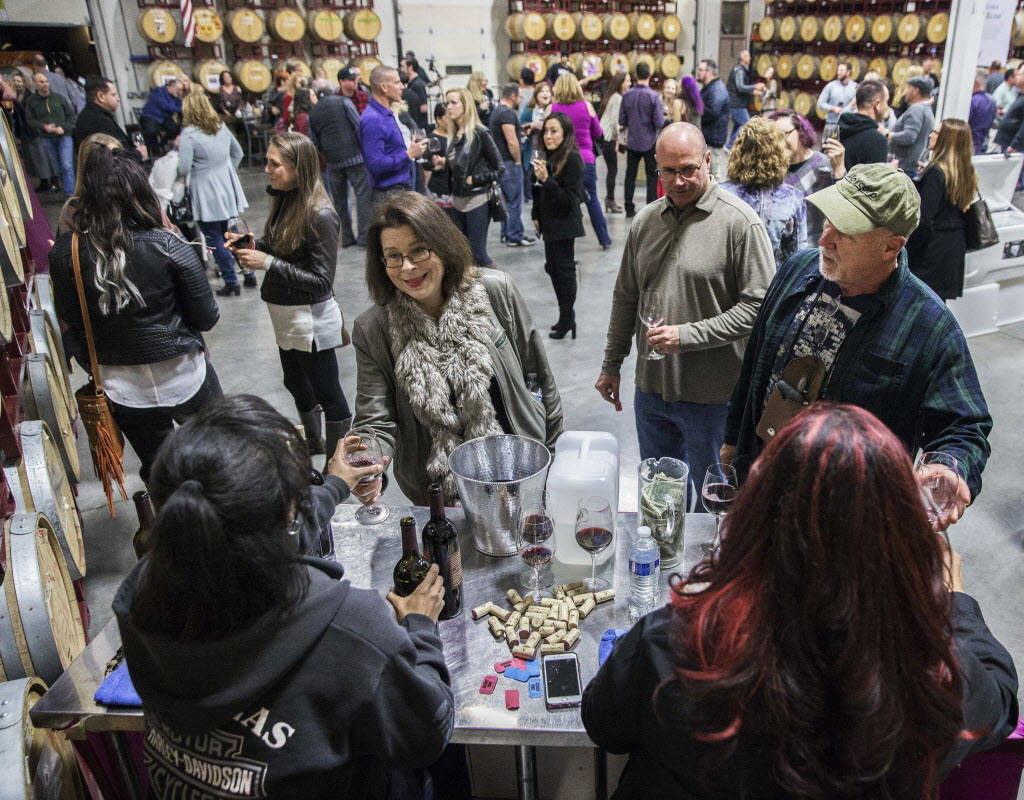 Pamela Graika, left, is served a glass of wine during the grand opening of Vegas Valley Winery on Saturday, January 20, 2018, in Las Vegas. Benjamin Hager Las Vegas Review-Journal @benjaminhphoto