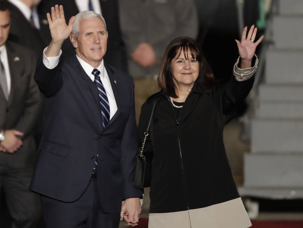 Vice President Mike Pence and his wife Karen wave as they landed at Tel Aviv airport Sunday, Jan. 21, 2018. Pence will pay a three day visit to Israel. (Tsafrir Abayov/AP)