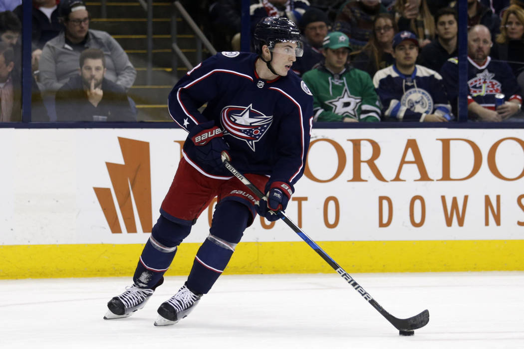 Columbus Blue Jackets defenseman Zach Werenski carries the puck against the Dallas Stars during the an NHL hockey game in Columbus, Ohio, Thursday, Jan. 18, 2018. The Blue Jackets won 2-1 in a sho ...
