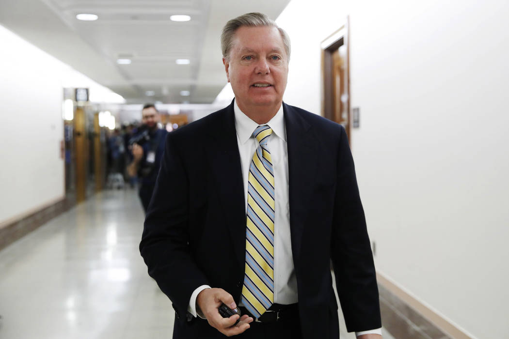 Sen. Lindsey Graham, R-S.C., leaves after meeting with a bipartisan group of senators, Monday Jan. 22, 2018, on Day Three of the government shutdown on Capitol Hill in Washington. (Jacquelyn Marti ...