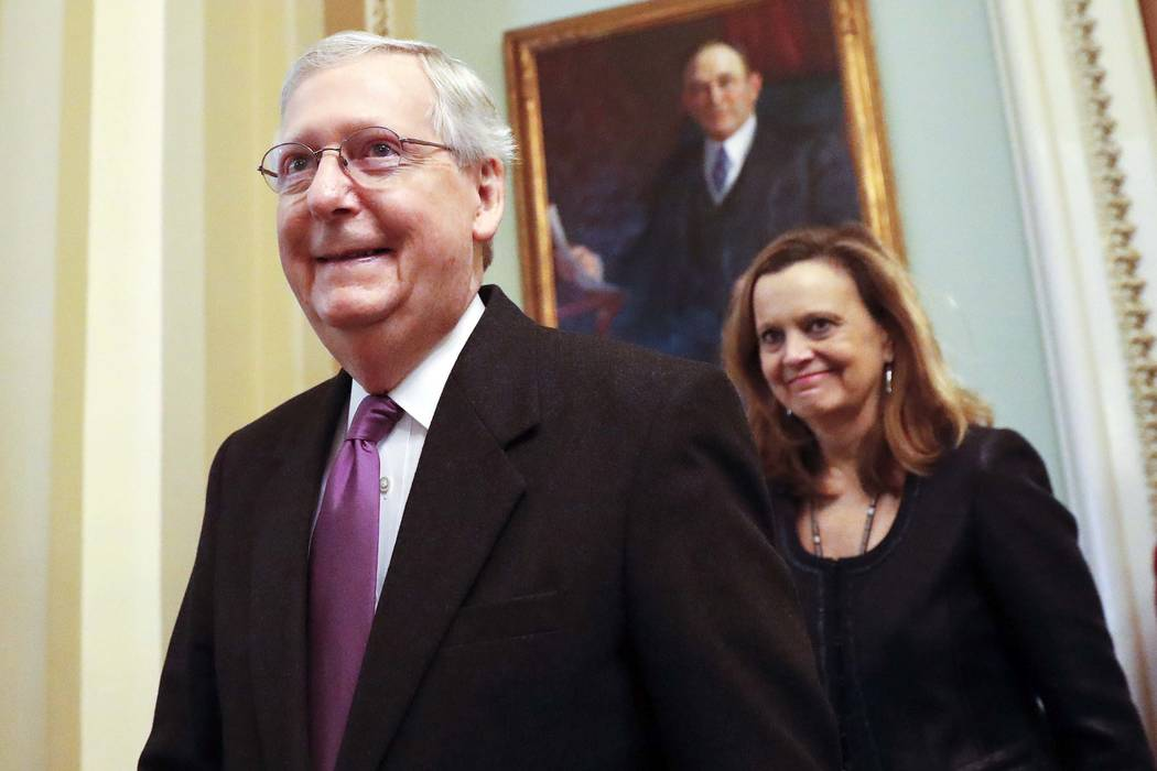 Senate Majority Leader Mitch McConnell of Kentucky walks back to his office on Capitol Hill in Washington, Monday, Jan. 22, 2018. Senate leaders have reached an agreement to advance a bill ending  ...