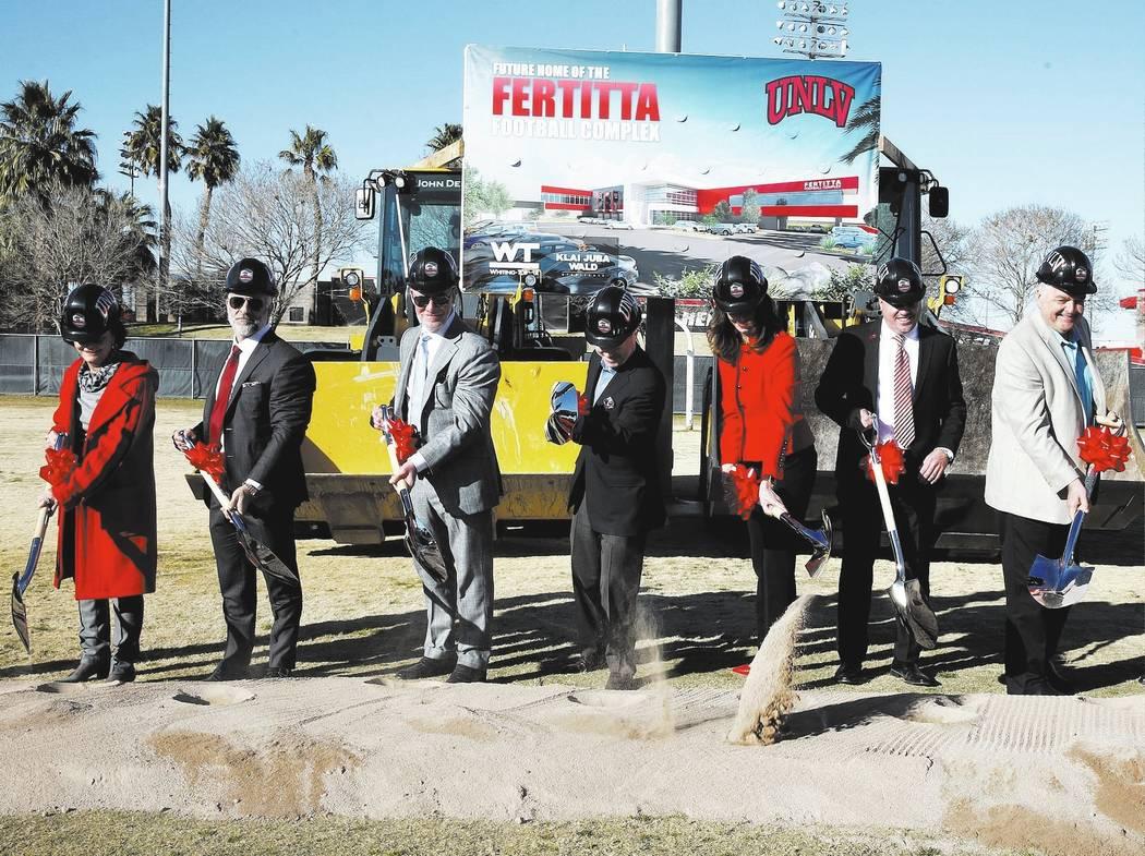 Vicki Fertitta, left, Lorenzo Fertitta, Frank Fertitta, UNLV President Dr. Len Jessup, Director of Athletics Desiree Reed-Francois, UNLV football head coach Tony Sanchez, and Clark County Commissi ...
