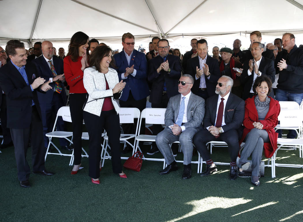 Frank Fertitta, left seated, Lorenzo Fertitta, and Vicki Fertitta, right, receive a standing ovation on Tuesday, Jan. 23, 2018 for their $10 million donation to UNLV to fund a 73,000-square-foot f ...