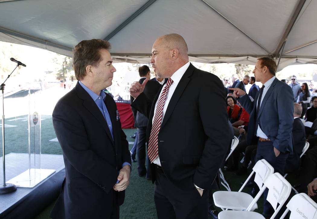 UNLV President Dr. Len Jessup, left, and UNLV football head coach Tony Sanchez chat prior to the groundbreaking ceremony for the Fertitta Football Complex on Tuesday, Jan. 23, 2018 in Las Vegas. ( ...