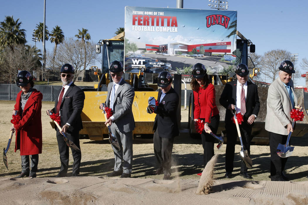 Vicki Fertitta, left, Lorenzo Fertitta, Frank Fertitta, UNLV President Dr. Len Jessup, Director of Athletics Desiree Reed-Francois, UNLV football head coach Tony Sanchez, and Clark County Commissi ...