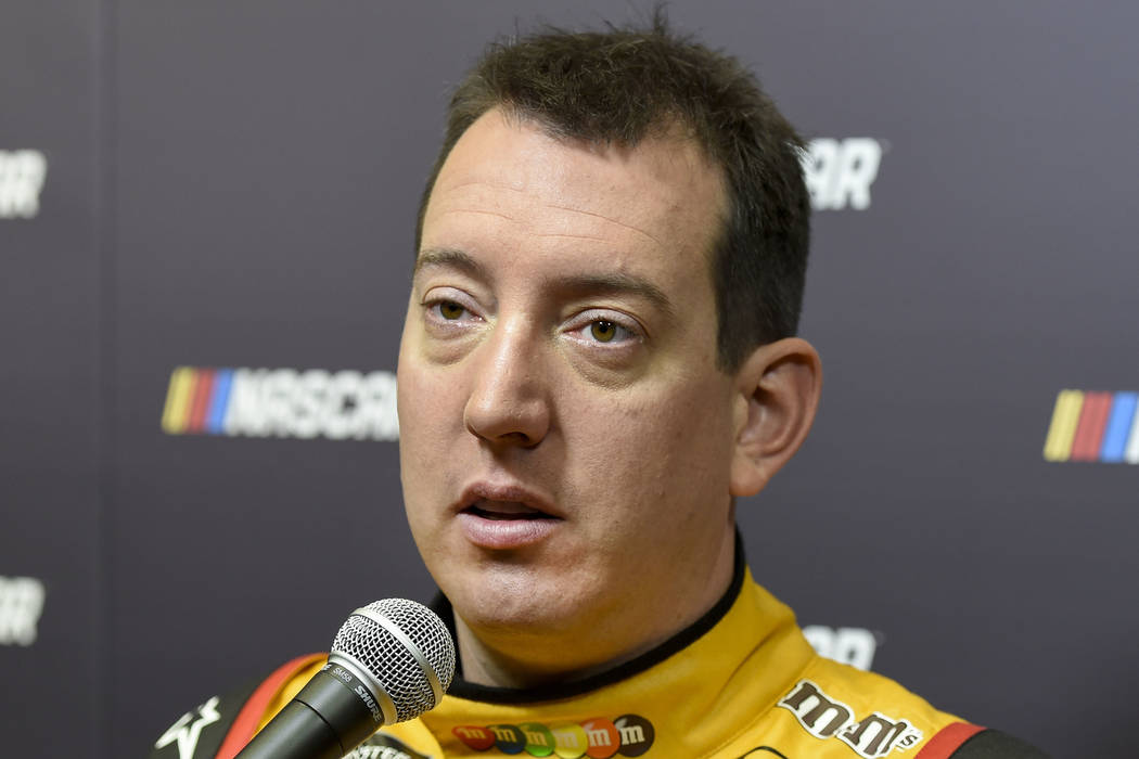 Kyle Busch talks to reporters about the upcoming season during the NASCAR Media Tour in Charlotte, N.C., Tuesday, Jan. 23, 2018. (AP Photo/Mike McCarn)