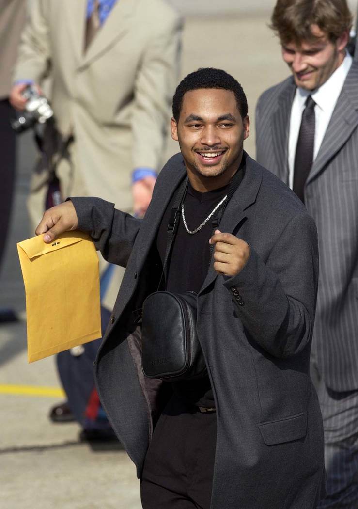 New England Patriots' Brock Williams dances to the sounds of the New Birth Brass Band on the tarmac afrter arriving in New Orleans Monday, Jan. 28, 2002. The Patriots will play the St. Louis Rams  ...