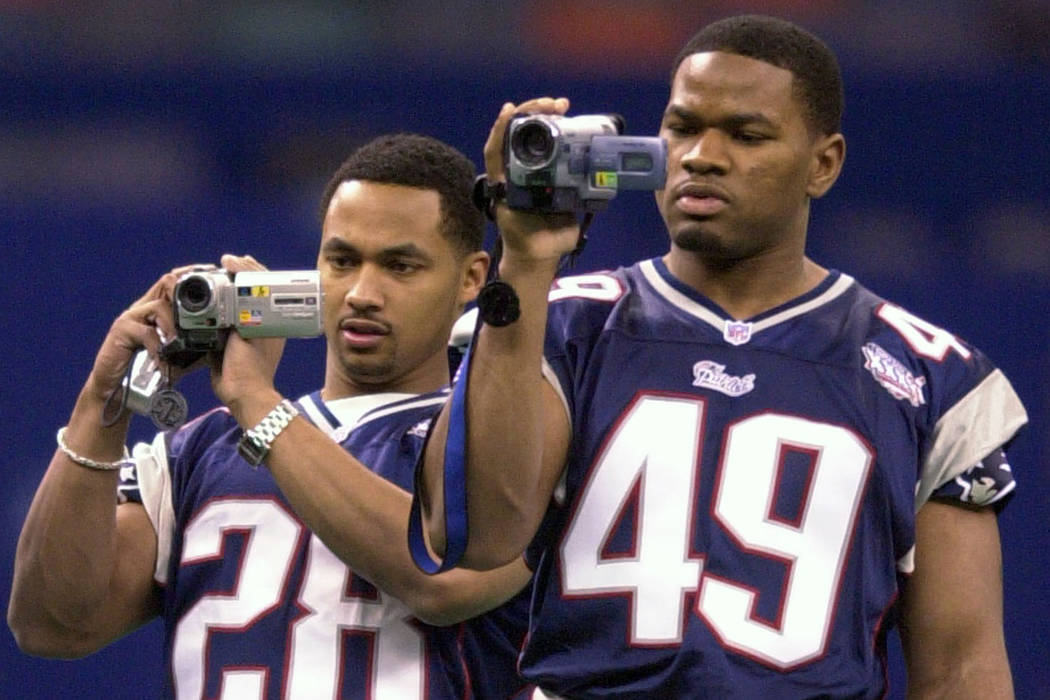 New England Patriots' Brock Williams (28) and Jabari Holloway (49) photograph the team's walk through at the Louisiana Superdome in New Orleans Saturday, Feb. 2, 2002. The Patriots face the St. Lo ...