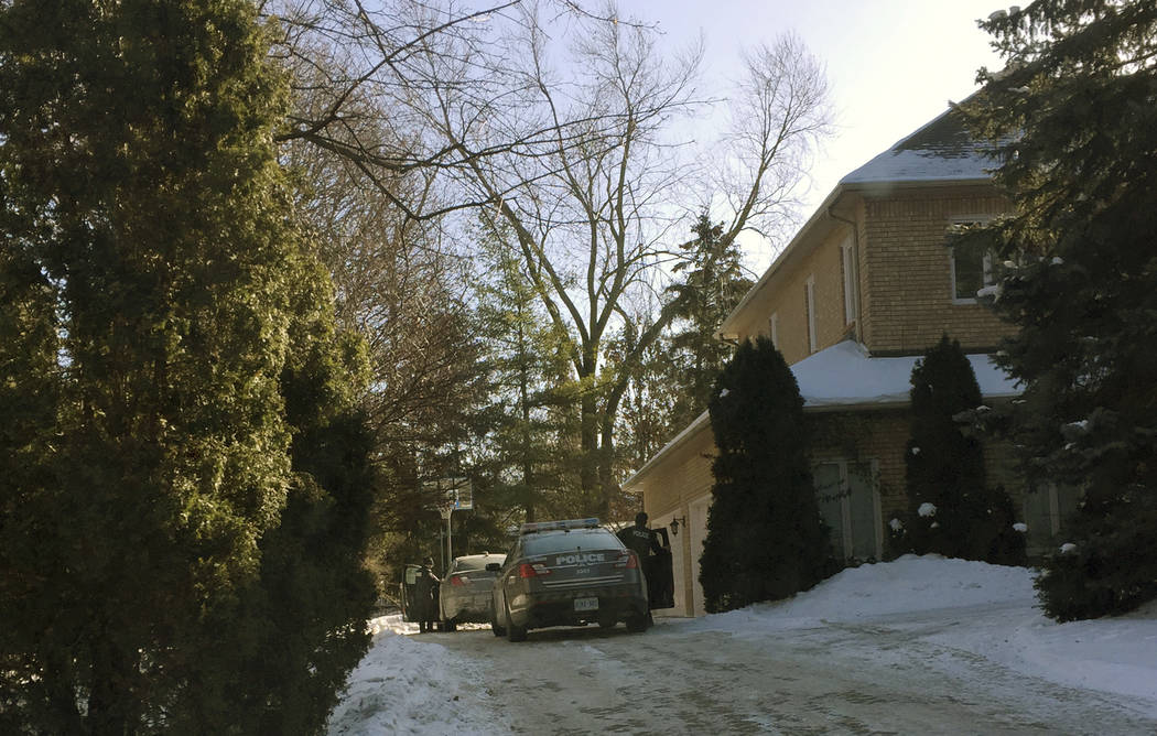 This Jan. 6, 2018 photo shows police prowlers parked outside the home of billionaire Barry Sherman and his wife Honey, in Toronto, Canada. There were no signs of forced entry when the Canadian bil ...