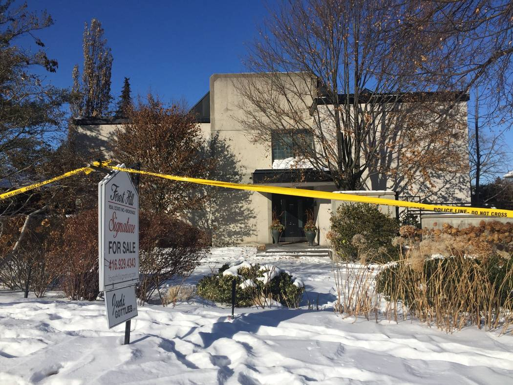 This Jan. 6, 2018 photo shows police crime scene tape marking off the property belonging to Barry and Honey Sherman, who were found strangled inside their home on Dec. 15, 2017. Since that time, i ...