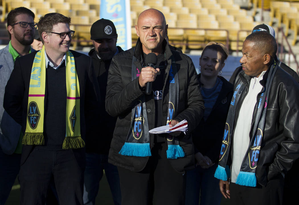 Las Vegas Lights FC owner Brett Lashbrook, from left, head coach José Luis Sánchez Solá, and Clark County Commissioner Lawrence Weekly, during an event to lay the first pieces of tu ...