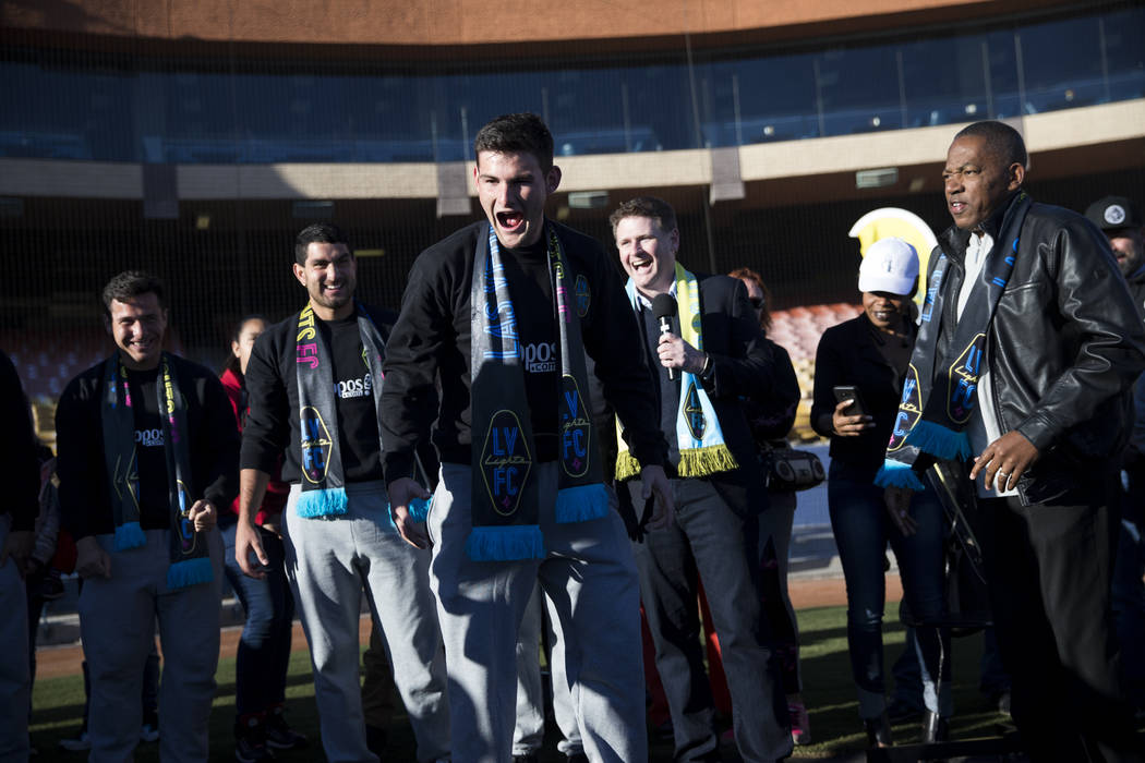 Las Vegas Lights FC player Matt Thomas lets out a roar during an event to lay the first pieces of turf at Cashman Field to help transition the stadium from a baseball to a soccer venue, in Las Veg ...