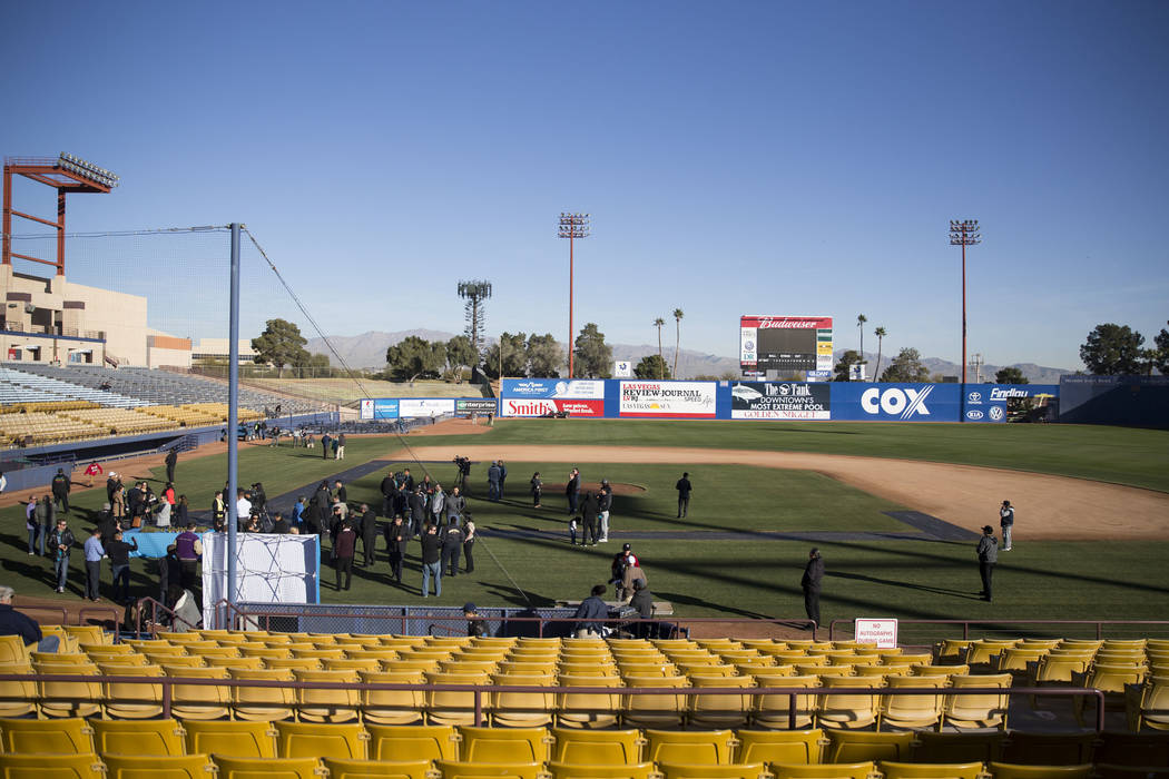 People, including players, coaches and digntitaries attend a Las Vegas Lights FC event to lay the first pieces of turf at Cashman Field to help transition the stadium from a baseball to a soccer v ...