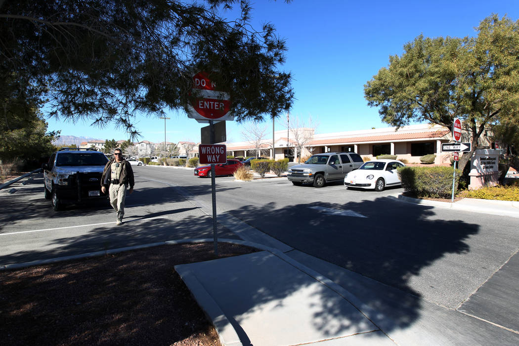 A ranger checks on a photographer at a closed U.S. Government office building at 4701 N. Torrey Pines Drive in Las Vegas Monday, Jan. 22, 2018. The building that houses the Bureau of Land Manageme ...