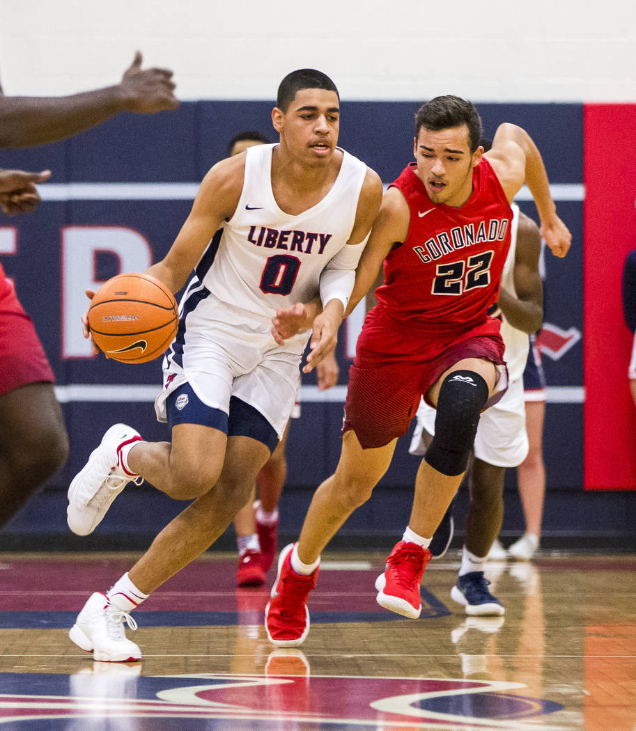 Liberty's Julian Strawther (0) dribbles around Coronado's Patrick Simms (22) at Liberty High School on Tuesday, Jan. 23, 2018. Liberty won 98-87.  Patrick Connolly Las Vegas Review-Journal @PConnPie