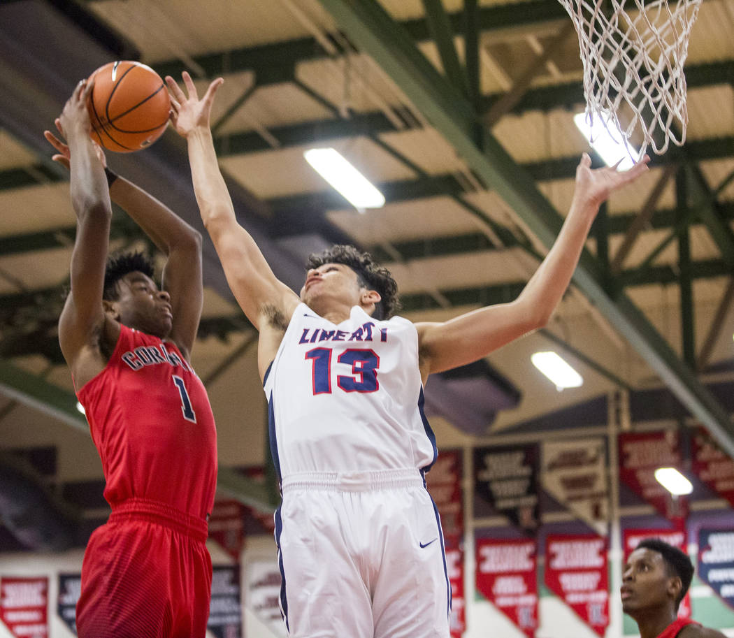 Coronado's Jaden Hardy (1) shoots while Liberty's Terrance Marigney (13) tries to block him at Liberty High School on Tuesday, Jan. 23, 2018. Liberty won 98-87.  Patrick Connolly Las Vegas Review- ...