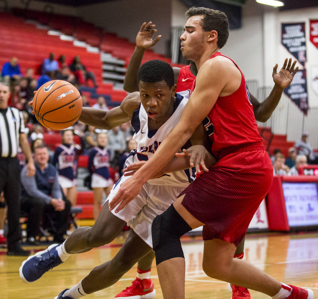 Liberty's Jordan Wafer (22) tries to dribble around Coronado's Patrick Simms (22) at Liberty High School on Tuesday, Jan. 23, 2018. Liberty won 98-87.  Patrick Connolly Las Vegas Review-Journal @P ...
