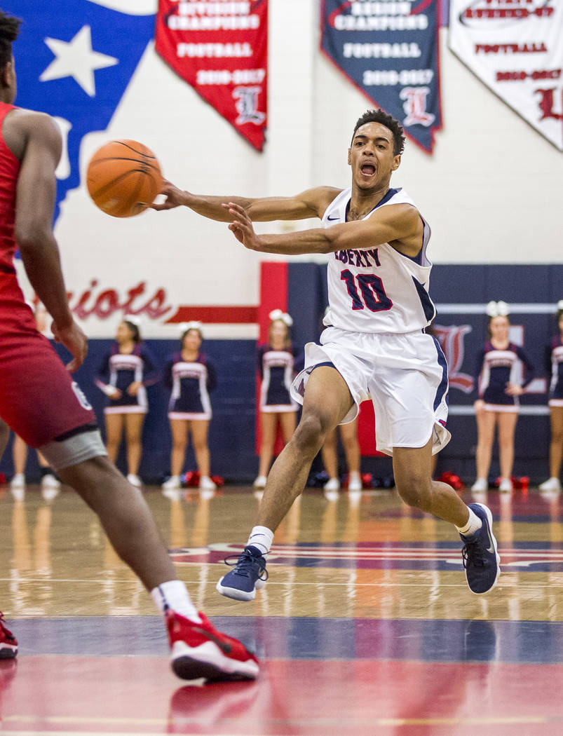 Liberty's Tyrelle Hunt (10) dribbles down the court while Coronado's Jaden Hardy (1), left, tries to block him at Liberty High School on Tuesday, Jan. 23, 2018. Liberty won 98-87.  Patrick Connoll ...