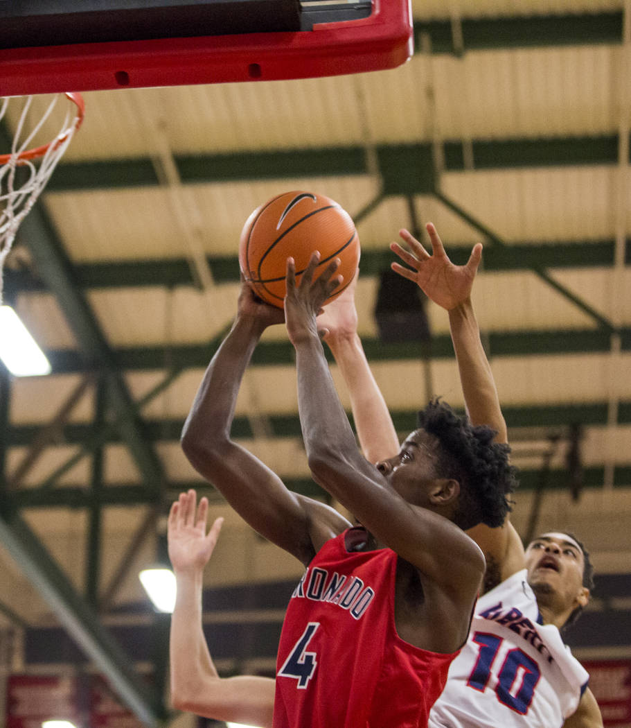 Coronado's Tahj Comeaux (4) goes up for a shot while Liberty's Jordan Holt (10) tries to block behind him at Liberty High School on Tuesday, Jan. 23, 2018. Liberty won 98-87.  Patrick Connolly Las ...