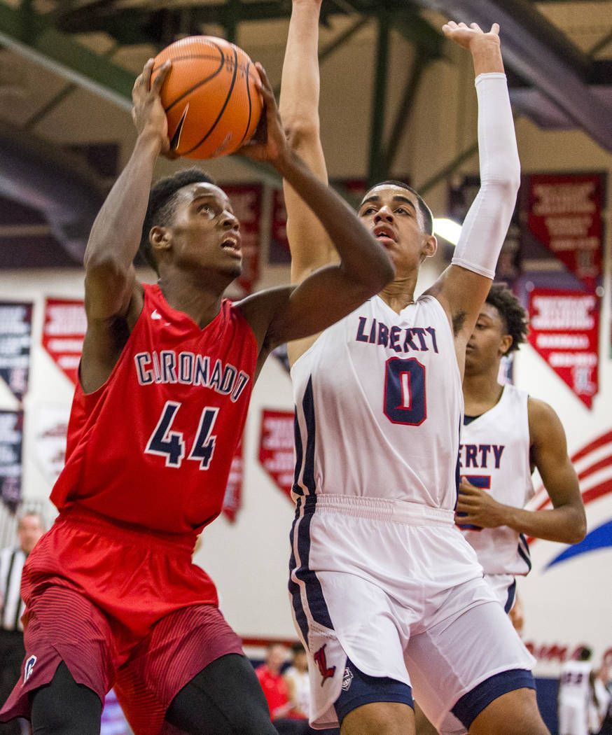 Coronado's Taieem Comeaux (44) goes up for a shot while Liberty's Julian Strawther (0) tries to block him at Liberty High School on Tuesday, Jan. 23, 2018. Liberty won 98-87.  Patrick Connolly Las ...