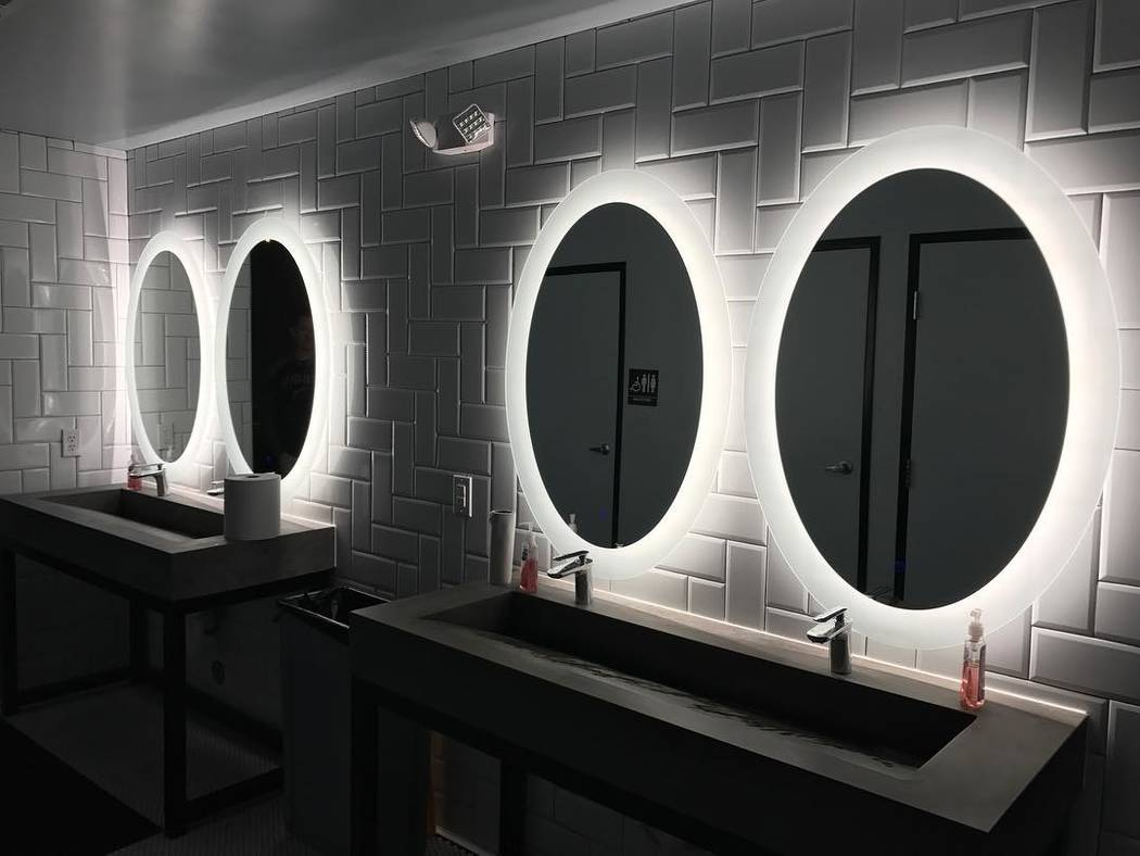 The bathrooms at G.O.A.T. Sports Bar continues the modern interior design theme. (Patrick Hua)