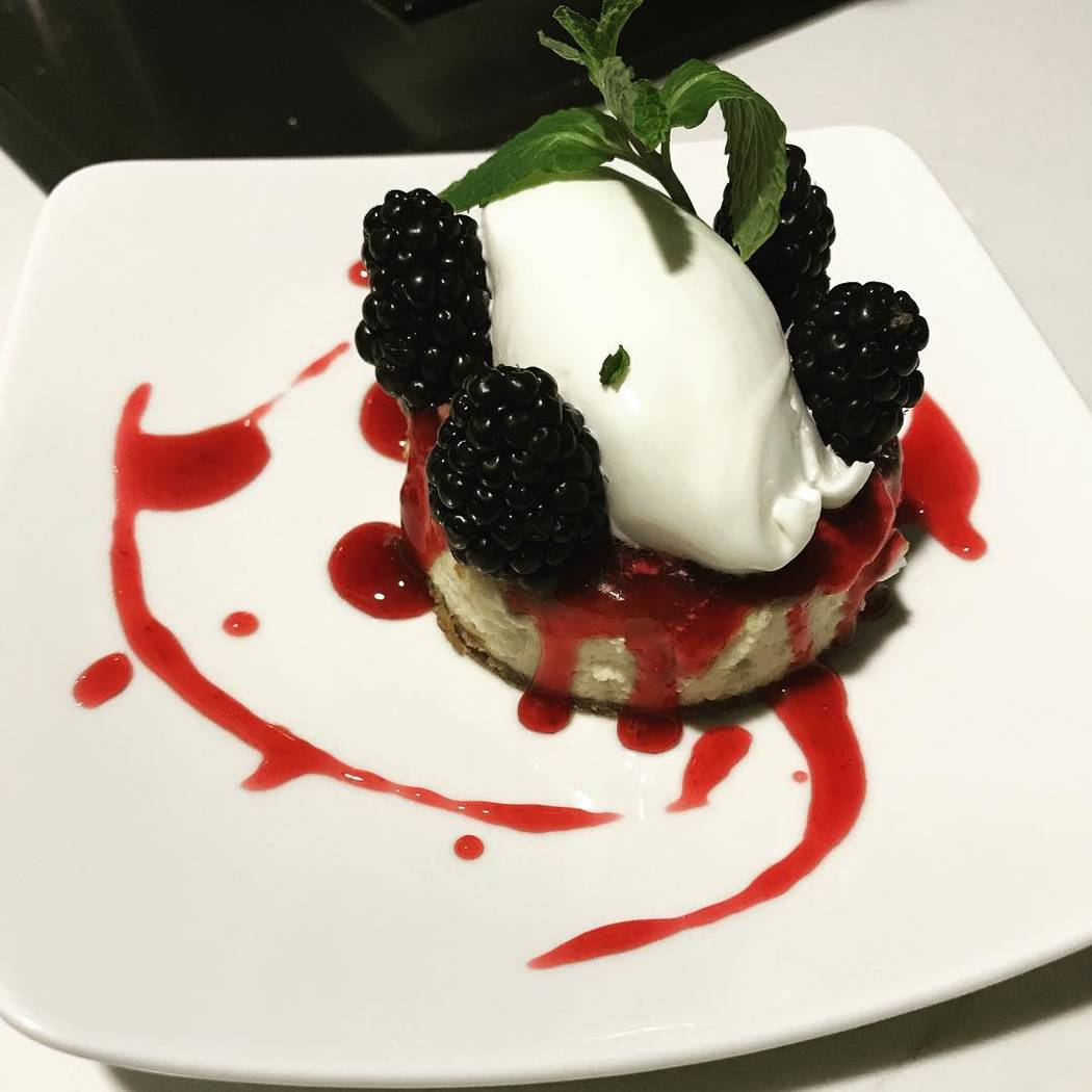 Cheesecake topped with blackberries, mint and a berry drizzle. (Patrick Hua)