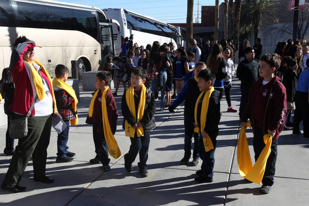Students from Coral Academy arrive at the UNLV campus to celebrate National School Choice Week Tuesday, Jan. 23, 2018. Over 1,800 students, teacher and families watched several student performance ...