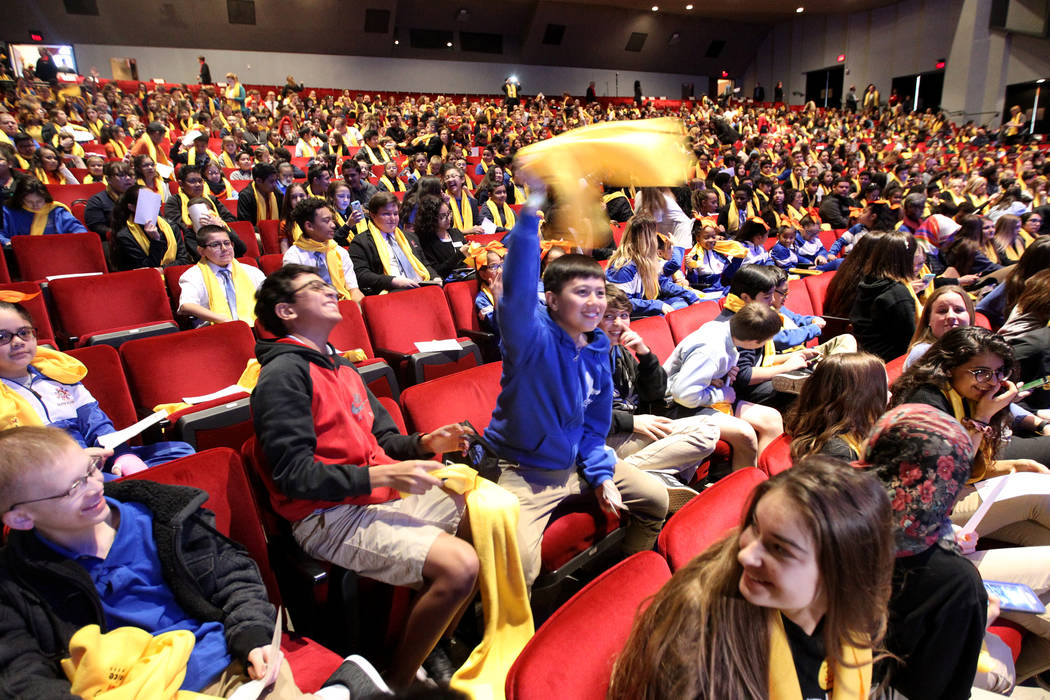 Makoto Ohki from Coral Academy, center, waves his scarf at UNLV to celebrate National School Choice Week Tuesday, Jan. 23, 2018. Over 1,800 students, teacher and families watched several student p ...