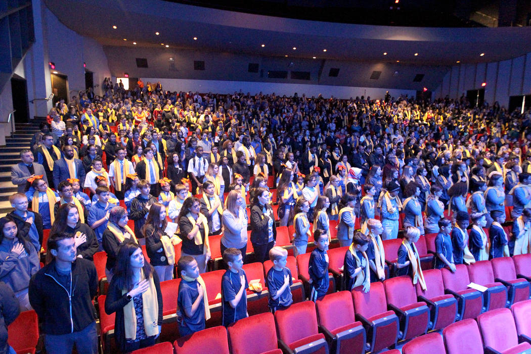 Students sing the National Anthem at UNLV to celebrate National School Choice Week Tuesday, Jan. 23, 2018. Over 1,800 students, teacher and families watched several student performances at Artemus ...