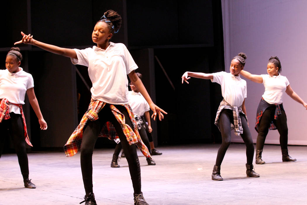 Students from Imagine 100 Academy of Excellence perform at UNLV to celebrate National School Choice Week Tuesday, Jan. 23, 2018. Over 1,800 students, teacher and families watched several student p ...