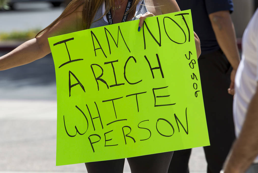 People hold signs as they participate in a rally in favor of education savings accounts, or ESAs, outside of the Sawyer Building in Las Vegas, Saturday, June 3, 2017. Richard Brian Las Vegas Revie ...