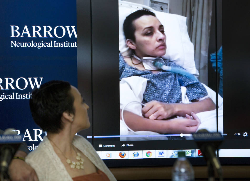 Route 91 Harvest shooting festival survivor Jovanna Calzadillas of San Tan Valley, Ariz. watches a video clip of herself in a hospital bed during a press conference on her recovery at the Barrow N ...