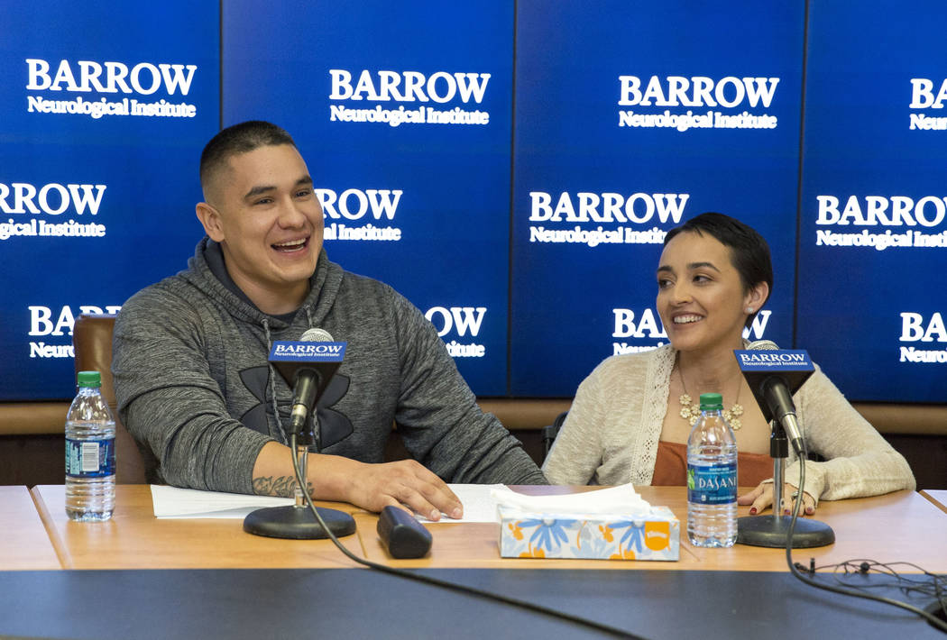 Route 91 Harvest festival survivors Jovanna Calzadillas and her husband Frank Calzadillas of San Tan Valley, Ariz., during a press conference at the Barrow Neurological Institute at St. Joseph's H ...
