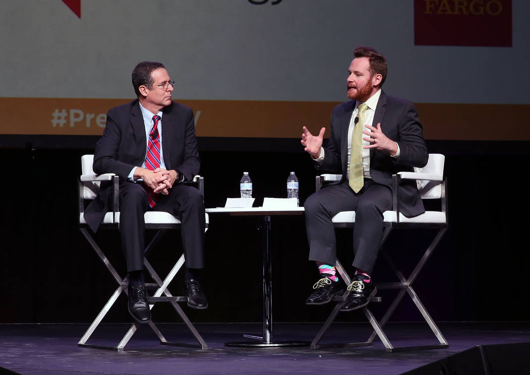 John Hudak, right, speaks during Preview Las Vegas, the Las Vegas Metropolitan Chamber of Commerce's largest annual networking event, as Rob Lang looks on at Cox Pavilion on Friday, Jan. 26, 201 ...