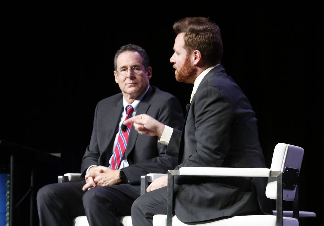 John Hudak, right, speaks during Preview Las Vegas, the Las Vegas Metropolitan Chamber of Commerce's largest annual networking event, as Rob Lang looks on at Cox Pavilion on Friday, Jan. 26, 2018, ...