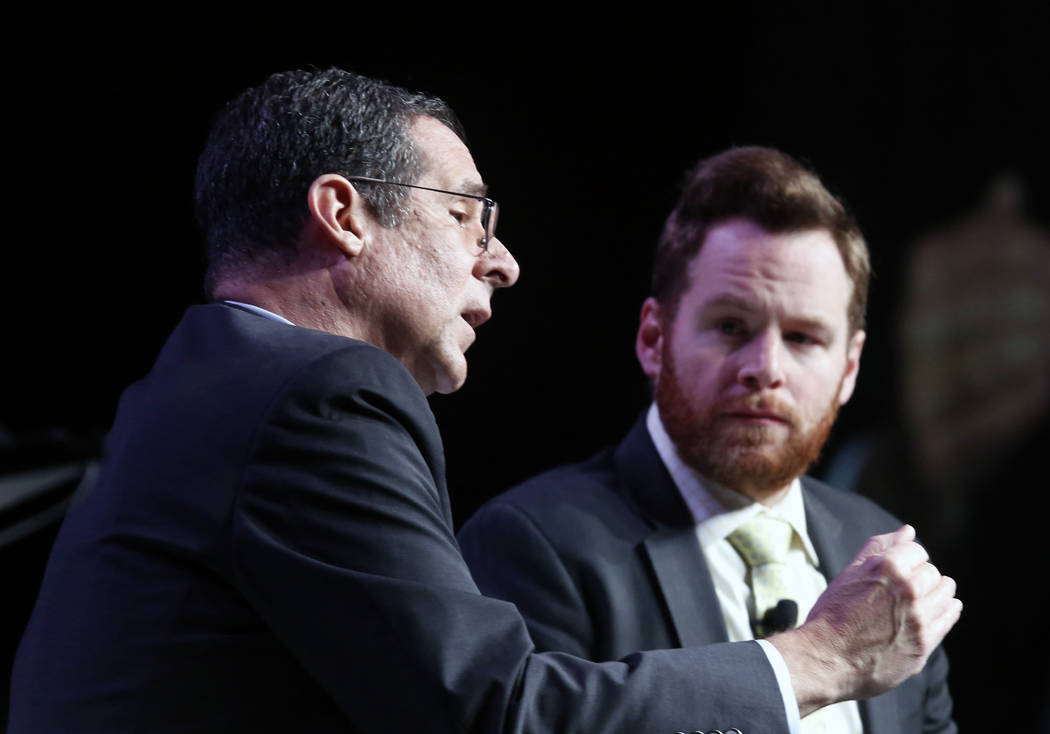 Rob Lang, left, speaks during Preview Las Vegas, the Las Vegas Metropolitan Chamber of Commerce's largest annual networking event, as John Hudak looks on at Cox Pavilion on Friday, Jan. 26, 2018,  ...