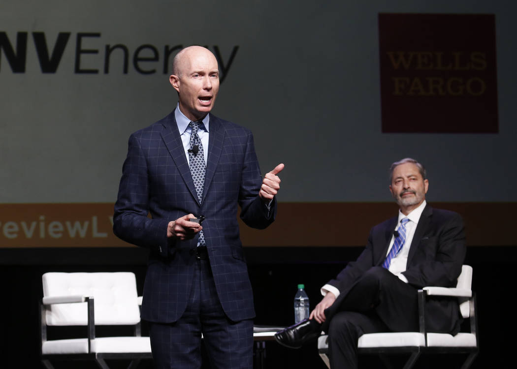 Mike PeQueen, left, of HighTower Las Vegas speaks during Preview Las Vegas, the Las Vegas Metropolitan Chamber of Commerce's largest annual networking event, as John Restrepo of RCG Economics look ...