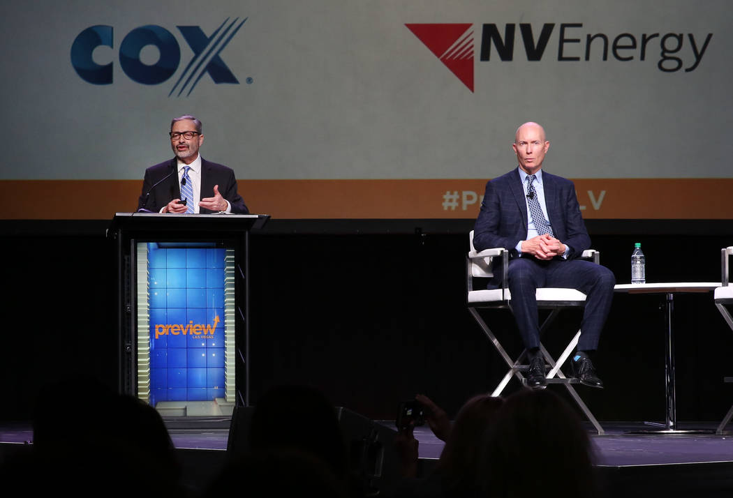 Mike PeQueen, right, of HighTower Las Vegas listens as John Restrepo of RCG Economics speaks during Preview Las Vegas, the Las Vegas Metropolitan Chamber of Commerce's largest annual networ ...