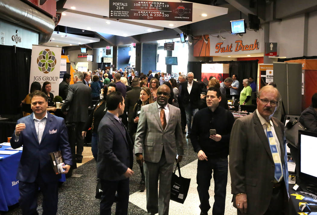 Exhibitgoers arrive at Preview Las Vegas, the Las Vegas Metropolitan Chamber of Commerce's largest annual networking event, at Cox Pavilion on Friday, Jan. 26, 2018, in Las Vegas. (Bizuayehu Tes ...