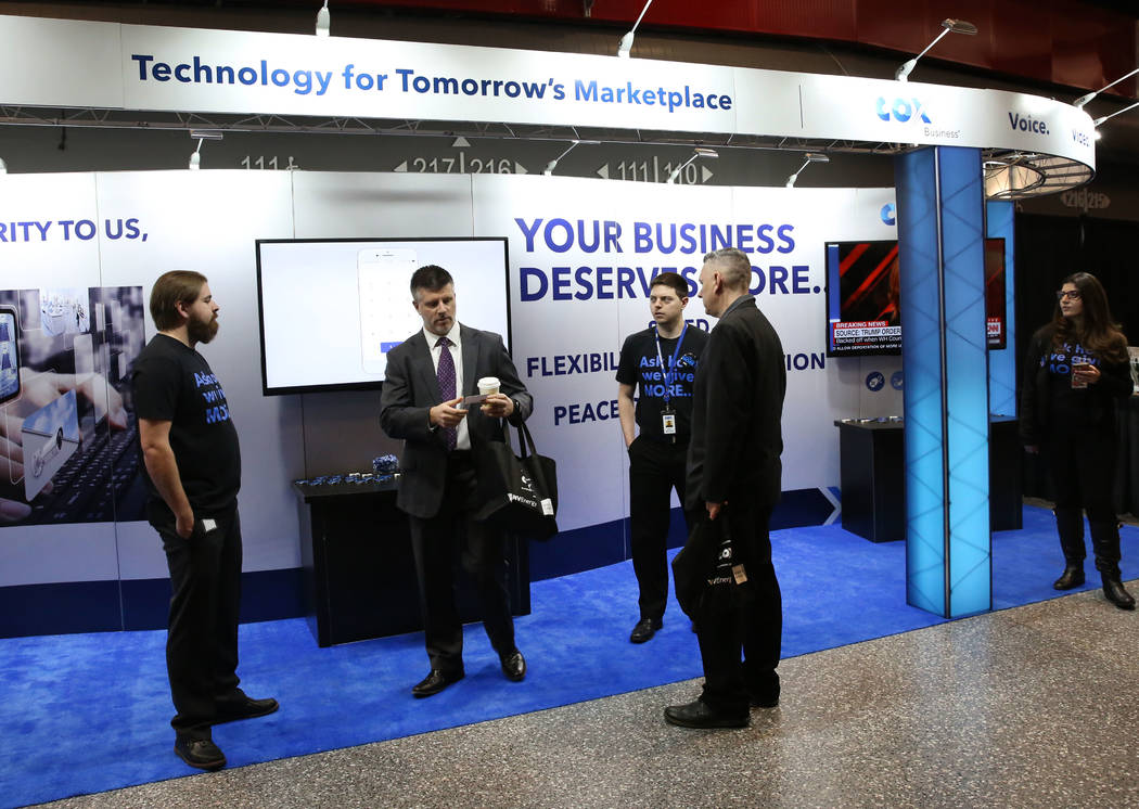 Exhibitgoers at COX booth during Preview Las Vegas, the Las Vegas Metropolitan Chamber of Commerce's largest annual networking event, at Cox Pavilion on Friday, Jan. 26, 2018, in Las Vegas. ...