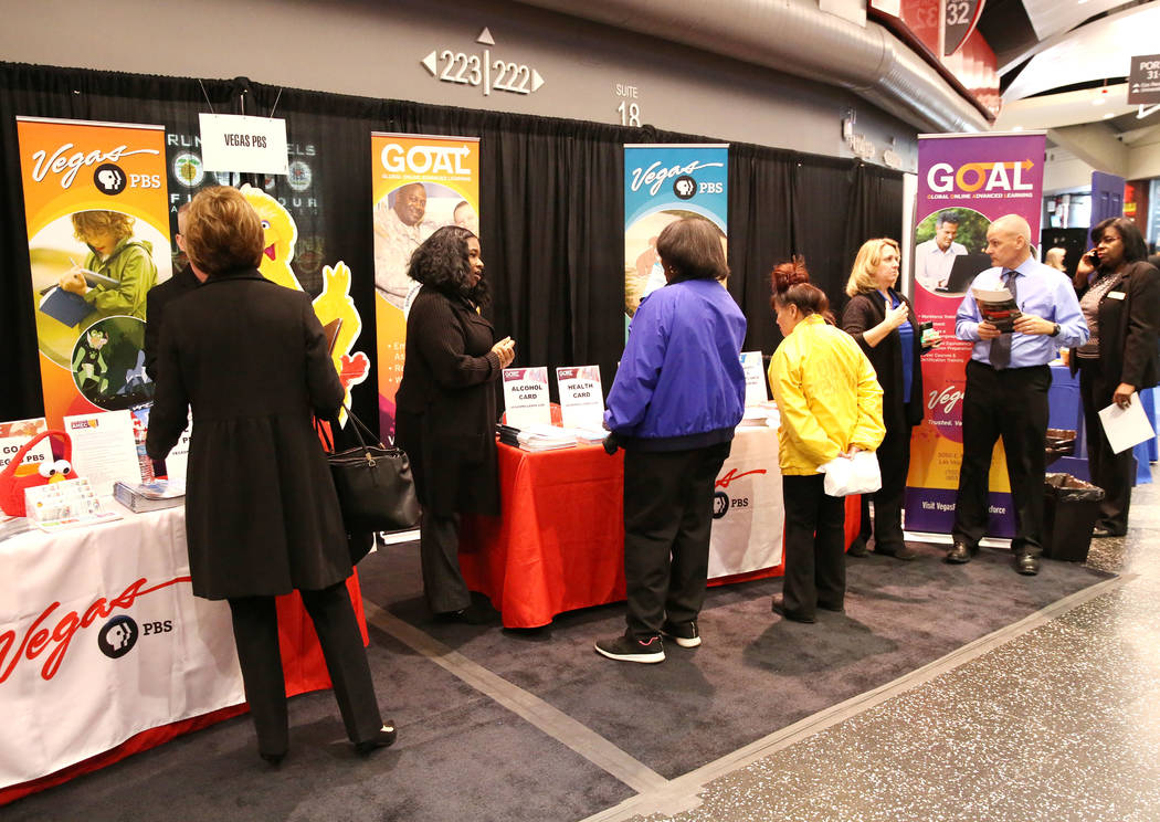 Exhibitgoers at Vegas PBS booth during Preview Las Vegas, the Las Vegas Metropolitan Chamber of Commerce's largest annual networking event, at Cox Pavilion on Friday, Jan. 26, 2018, in Las  ...