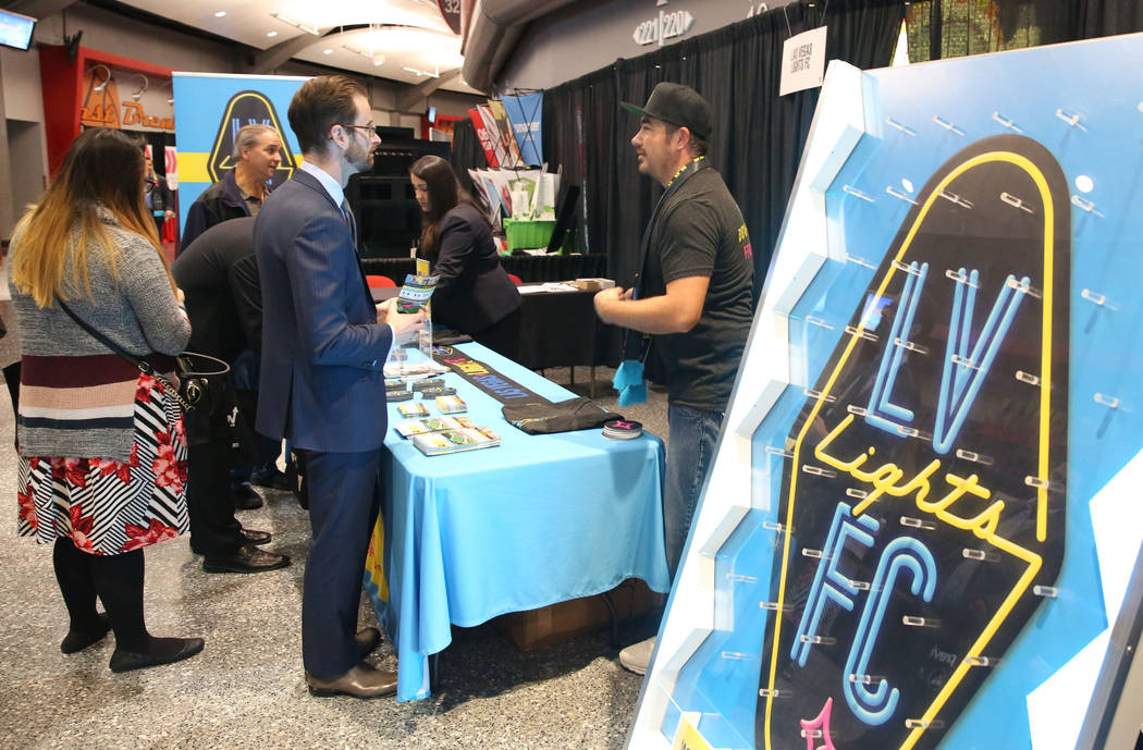 Martin Corbett, right, team ambassador for the Las Vegas Lights FC, speaks with exhibit-goers during Preview Las Vegas, the Las Vegas Metropolitan Chamber of Commerceճ largest annual network ...