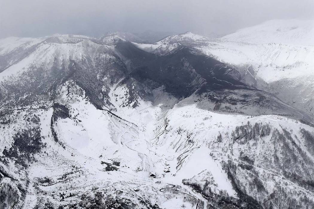 Avalanche and volcano hit Japan ski resort