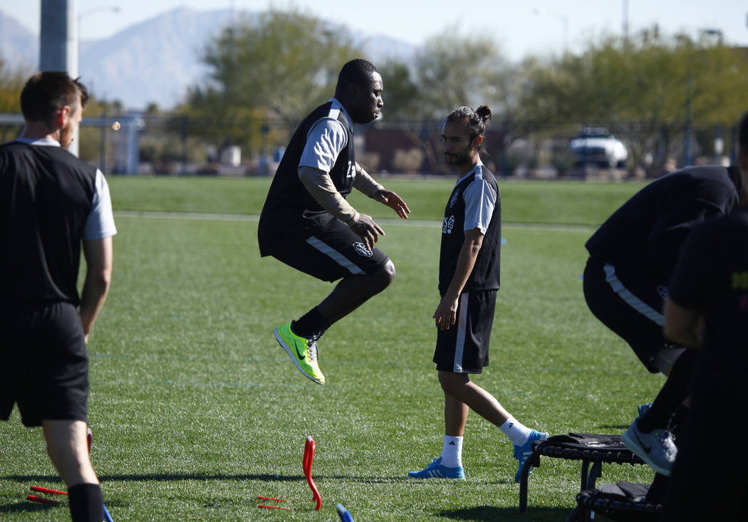Former U.S. national team member Freddy Adu, green shoes, jumps during a drill as he tries out for the Las Vegas Lights FC at the team's practice field in Las Vegas, Tuesday, Jan. 23, 2018. Heidi  ...