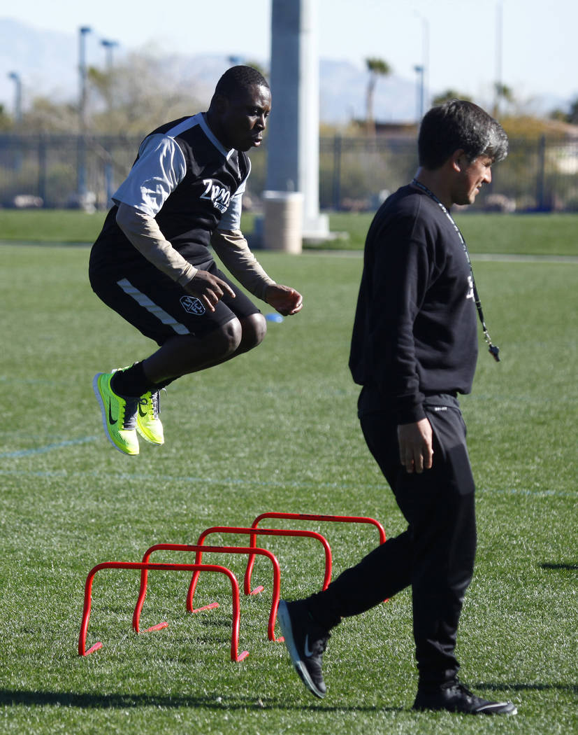 Former U.S. national team member Freddy Adu tries out for the Las Vegas Lights FC as coach Jose Luis Sanchez Sola walks by at the team's practice field in Las Vegas, Tuesday, Jan. 23, 2018. Heidi  ...