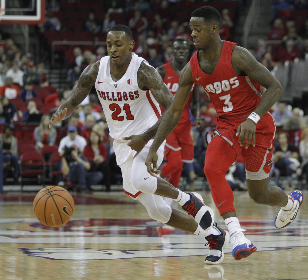 New Mexico's Antino Jackson and Fresno State's Deshon Taylor fight for a loose ball during the second half of an NCAA college basketball game in Fresno, Calif., Saturday, Jan. 13, 2018. Fresno Sta ...
