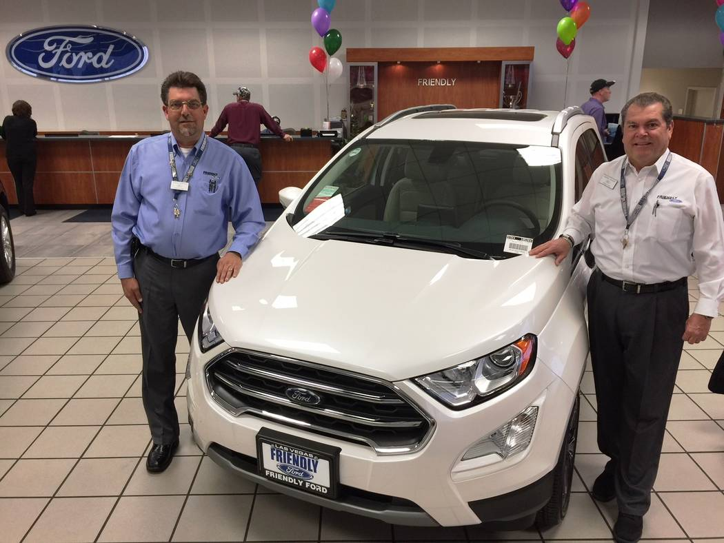 Friendly Ford Friendly Ford training manager David Boehle, left, and dealership sales consultant Rafael DeLeon are seen with the new 2018 Ford EcoSport SUV which was recently delivered to the deal ...
