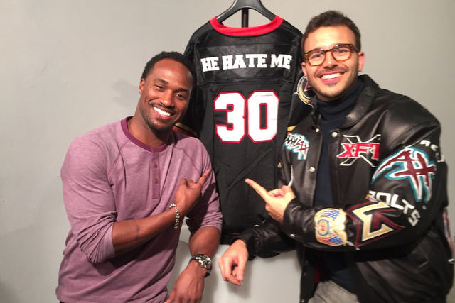 "Former Las Vegas Outlaws star Rod Smart, left, and filmmaker Charlie Ebersol pose in front of Smart's iconic ""He Hate Me"" jersey to promote the ESPN documentary ""This Was the XFL,"" which debuted F ..."