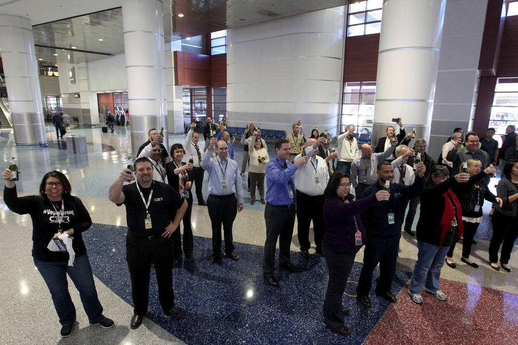 Employees toast with sparkling cider at McCarran International Airport during a celebration Wednesday, Jan. 24, 2018, marking the completion of a $30 million Terminal 1 renovation project. The ter ...